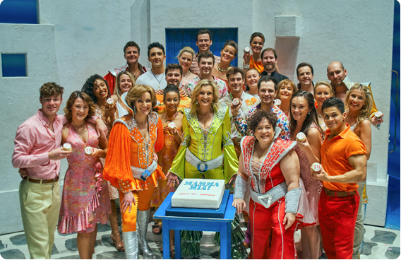 MAMMA MIA! London Cast with cake